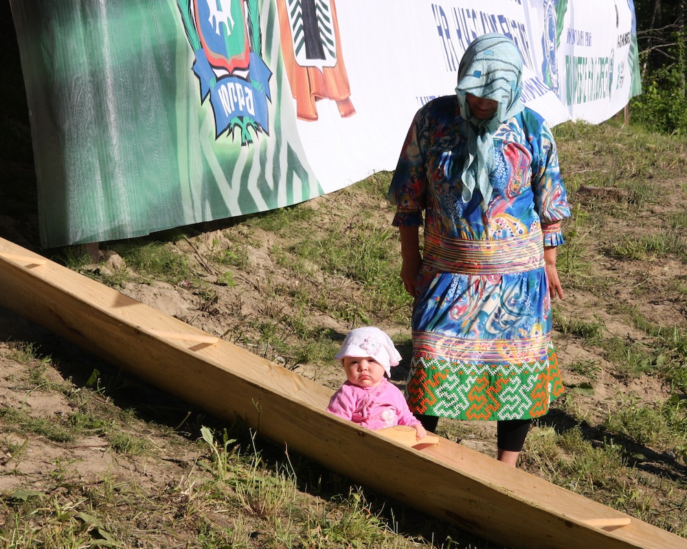 Grandmother and a child, Canoe races, 2014. Snowchange