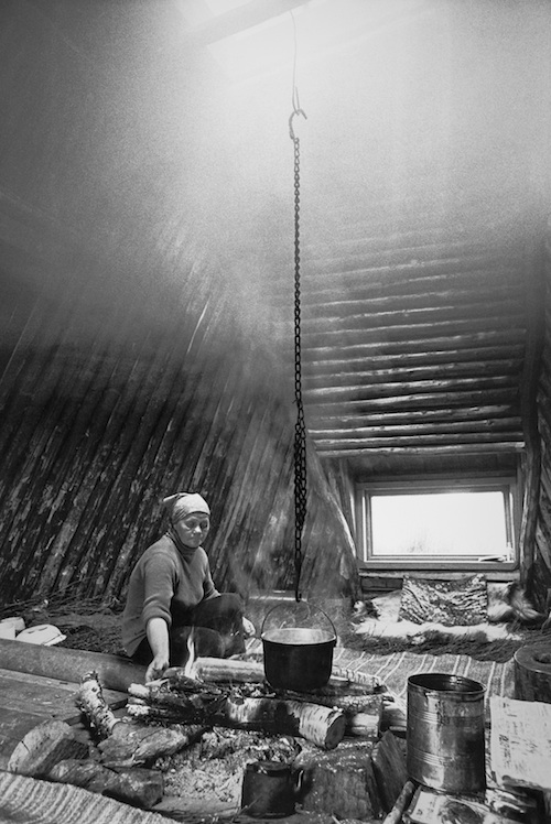 Anna Pilto in a traditional shelter in 1970s, Jokkmokk. Snowchange, 2016