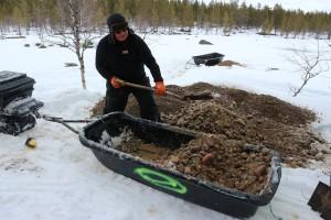 Markku shovels gravel.