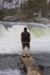 Nuunuq from Greenland observes Näätämö river at Skoltfossen. Hannibal Rhoades, used with permission