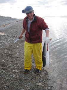 John MacDonald, coordinator of IOHP and editor of the new book, with a recently caught Arctic Char in Igloolik. Photo: John MacDonald.