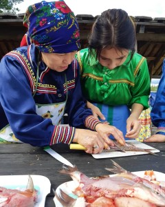 Older women taught the fish handling skills to the younger girls during the Festival 2019.