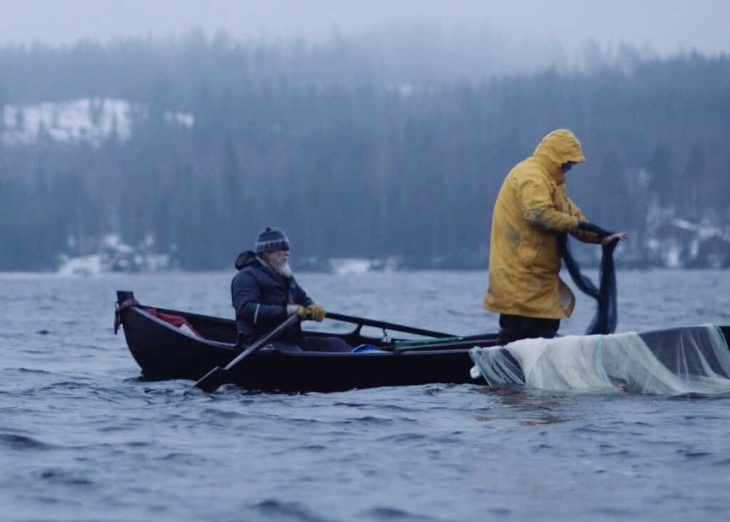 Markku Aho, rowing on the left, seining on a lake in Kontiolahti in 2014. Snowchange